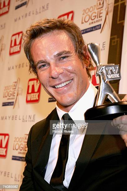 Actor Aaron Jeffery poses with the TV Week Silver Logie award for Most Popular Actor for his role in McLeod's Daughters backstage at the 2007 TV Week...