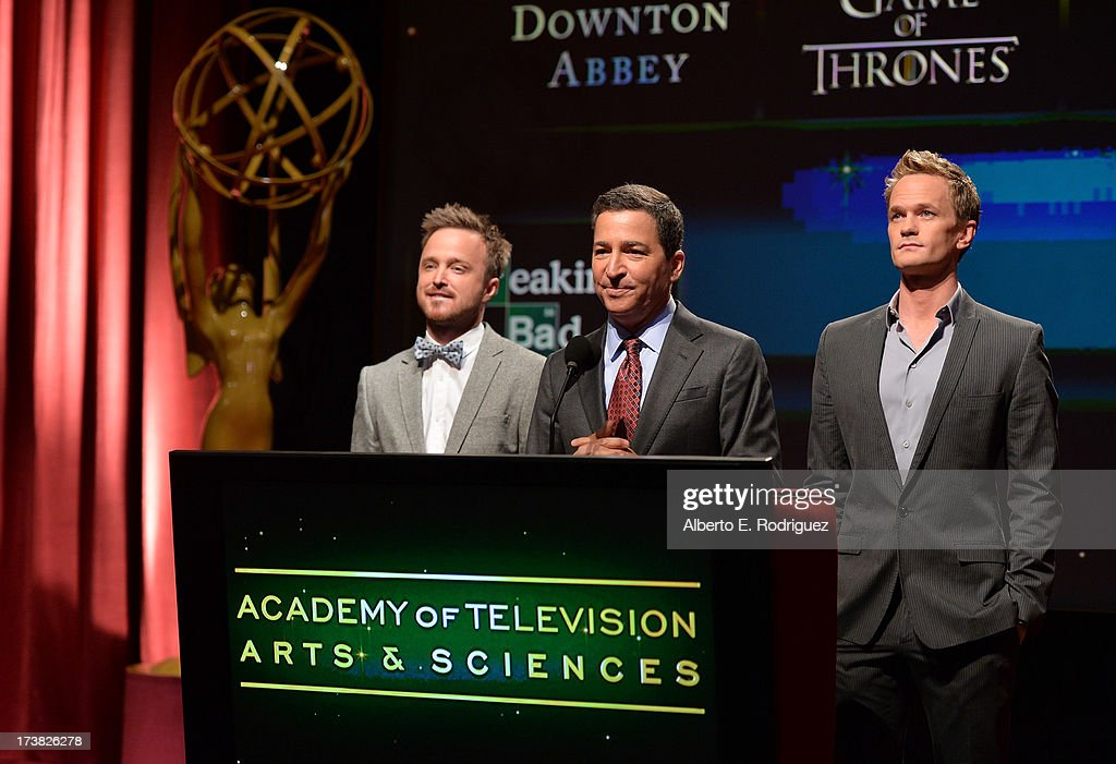 Actor Aaron Paul, Academy of Television Arts & Sciences Chairman & CEO Bruce Rosenblum and actor Neil Patrick Harris announce the nominees for the Outstanding Drama Series Award during the 65th Primetime Emmy Awards nominations at the Television Academy's Leonard H. Goldenson Theatre on July 18, 2013 in North Hollywood, California.