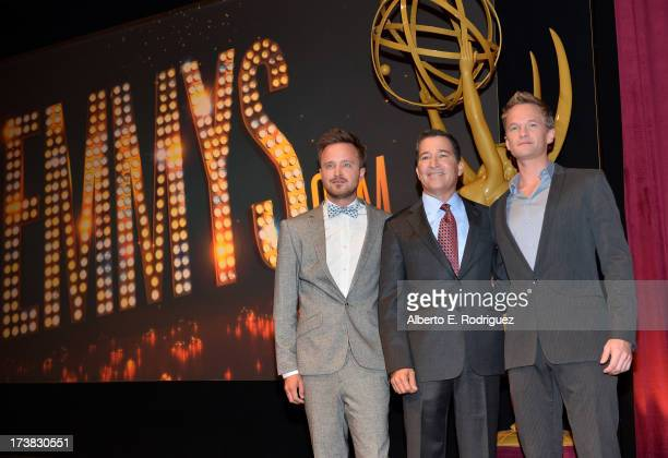 Actor Aaron Paul Academy of Television Arts Sciences Chairman CEO Bruce Rosenblum and actor Neil Patrick Harris pose onstage following the 65th...