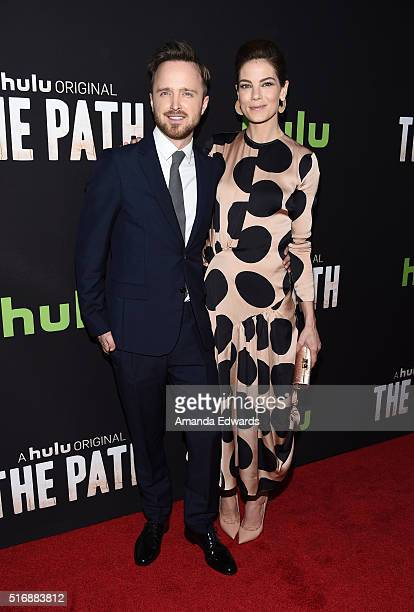 Actor Aaron Paul and actress Michelle Monaghan arrive at the premiere of Hulu's 'The Path' at the ArcLight Hollywood on March 21 2016 in Hollywood...