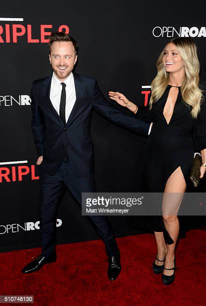 Actor Aaron Paul and director Lauren Parsekian attend the premiere of Open Road's 'Triple 9' at Regal Cinemas LA Live on February 16 2016 in Los...
