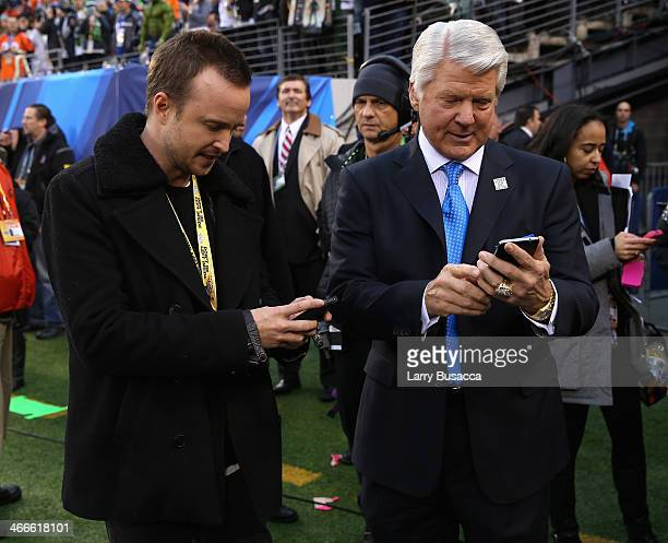 Actor Aaron Paul and Jimmy Johnson attend the Pepsi Super Bowl XLVIII Pregame Show at MetLife Stadium on February 2 2014 in East Rutherford New Jersey