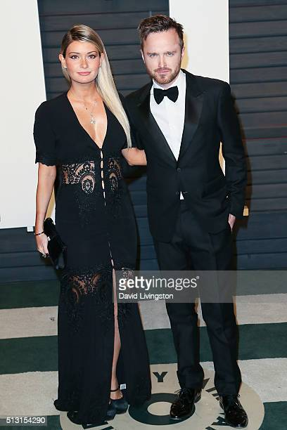 Actor Aaron Paul and Lauren Parsekian arrive at the 2016 Vanity Fair Oscar Party Hosted by Graydon Carter at the Wallis Annenberg Center for the...