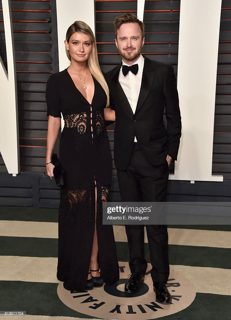 Actor Aaron Paul (R) and Lauren Parsekian attend the 2016 Vanity Fair Oscar Party hosted By Graydon Carter at Wallis Annenberg Center for the Performing Arts on February 28, 2016 in Beverly Hills, California.