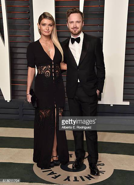 Actor Aaron Paul and Lauren Parsekian attend the 2016 Vanity Fair Oscar Party hosted By Graydon Carter at Wallis Annenberg Center for the Performing...