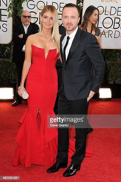 Actor Aaron Paul and Lauren Parsekian attend the 71st Annual Golden Globe Awards held at The Beverly Hilton Hotel on January 12 2014 in Beverly Hills...