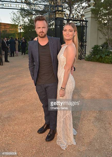 Actor Aaron Paul and Lauren Parsekian attend the Burberry 'London in Los Angeles' event at Griffith Observatory on April 16 2015 in Los Angeles...
