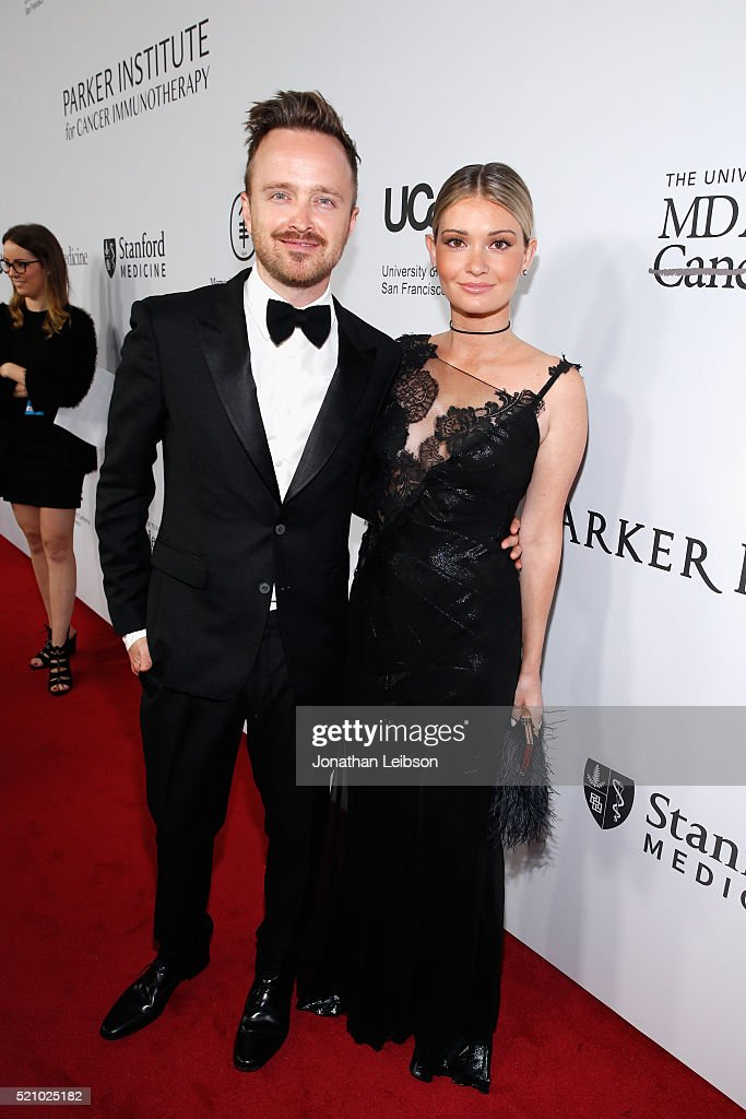 Actor Aaron Paul (L) and Lauren Parsekian attend the launch of the Parker Institute for Cancer Immunotherapy, an unprecedented collaboration between the country's leading immunologists and cancer centers on April 13, 2016 in Los Angeles, California.