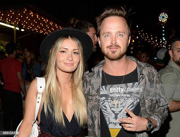 Actor Aaron Paul and Lauren Parsekian attend the Neon Carnival with PacSun 'Dope the Movie and Tequila Don Julio at the Thermal Hangar on April 11...