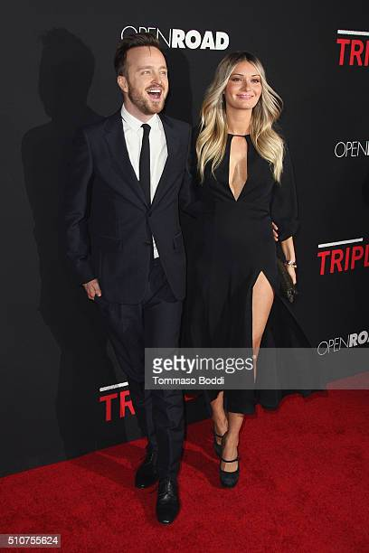 Actor Aaron Paul and Lauren Parsekian attend the premiere of Open Road's 'Triple 9' held at Regal Cinemas LA Live on February 16 2016 in Los Angeles...