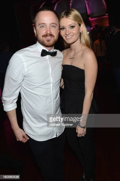 Actor Aaron Paul and Lauren Parsekian attends the Audi Forum New Orleans at the Ogden Museum of Southern Art on February 2 2013 in New Orleans...