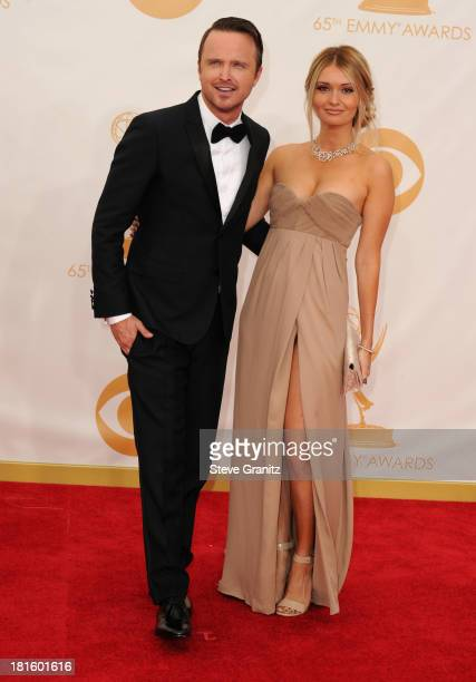 Actor Aaron Paul and producer Lauren Parsekian arrive at the 65th Annual Primetime Emmy Awards held at Nokia Theatre LA Live on September 22 2013 in...