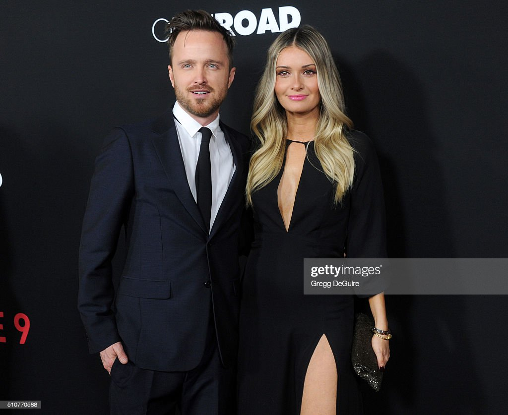 Actor Aaron Paul and wife Lauren Parsekian arrive at the premiere of Open Road's 'Triple 9' at Regal Cinemas L.A. Live on February 16, 2016 in Los Angeles, California.