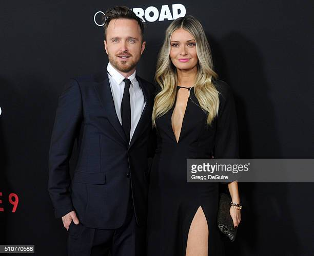 Actor Aaron Paul and wife Lauren Parsekian arrive at the premiere of Open Road's 'Triple 9' at Regal Cinemas LA Live on February 16 2016 in Los...
