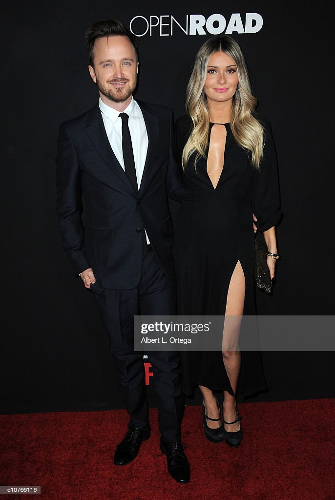 Actor Aaron Paul and wife Lauren Parsekian arrive for the premiere of Open Road's 'Triple 9' held at Regal Cinemas L.A. Live on February 16, 2016 in Los Angeles, California.