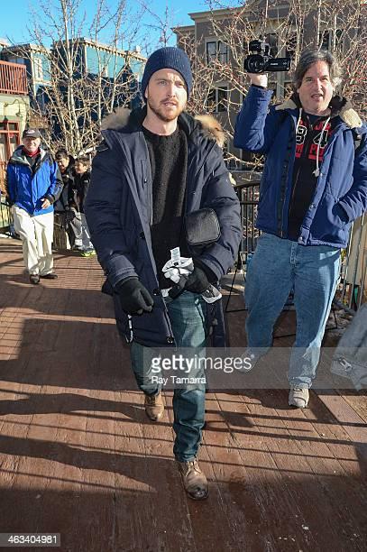 Actor Aaron Paul enters the WireImage portrait studio on January 17 2014 in Park City Utah