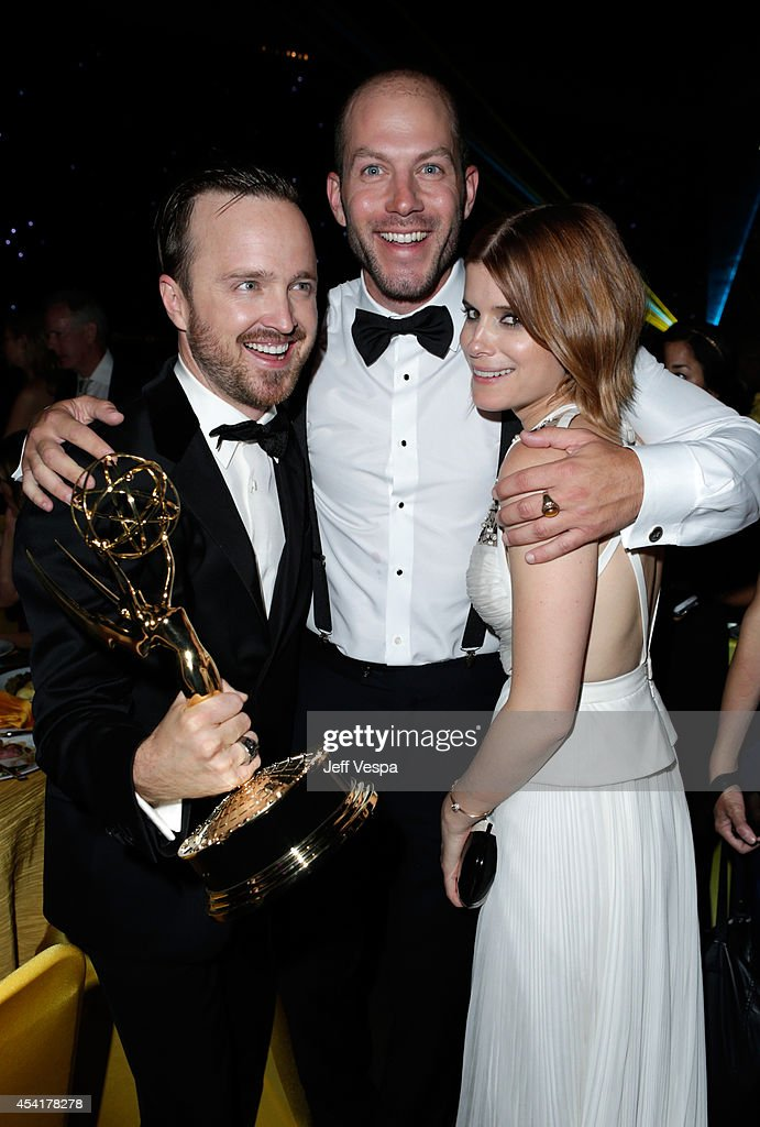 Actor Aaron Paul, guest and actress Kate Mara attend the 66th Annual Primetime Emmy Awards Governors Ball held at Los Angeles Convention Center on August 25, 2014 in Los Angeles, California.