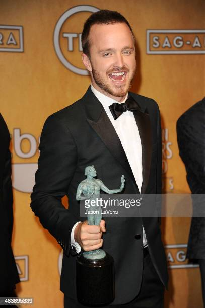 Actor Aaron Paul poses in the press room at the 20th annual Screen Actors Guild Awards at The Shrine Auditorium on January 18 2014 in Los Angeles...
