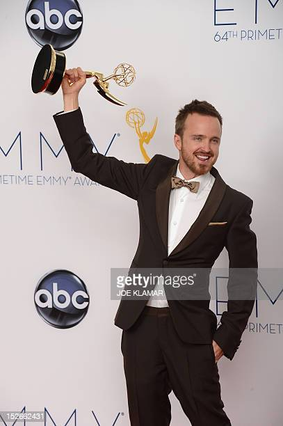 Actor Aaron Paul poses in the press room during the 64th Annual Primetime Emmy Awards on September 23, 2012 in Los Angeles. Lewis won Outstanding...