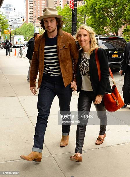Actor Aaron TaylorJohnson and filmmaker Sam TaylorJohnson enter their Tribeca hotel on June 4 2015 in New York City