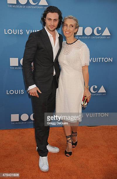 Actor Aaron TaylorJohnson and wife director Sam TaylorJohnson arrive at the 2015 MOCA Gala presented by Louis Vuitton at The Geffen Contemporary at...