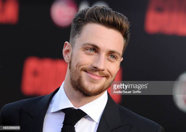 Actor Aaron TaylorJohnson arrives at the Los Angeles premiere of 'Godzilla' at Dolby Theatre on May 8 2014 in Hollywood California