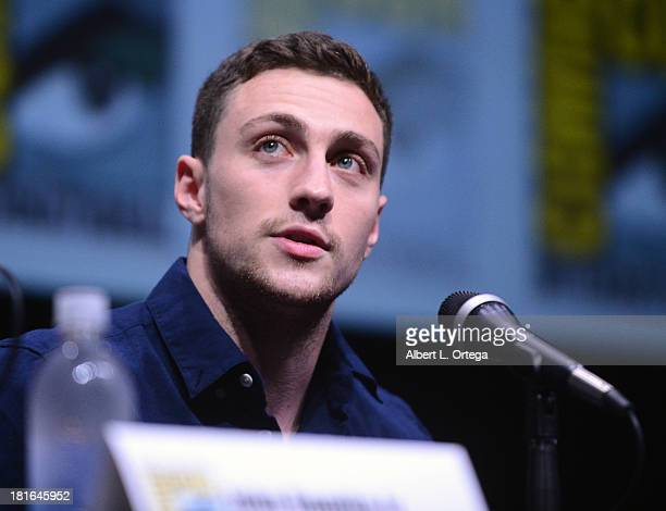 Actor Aaron TaylorJohnson attends The 'Kick Ass 2' And 'Riddick' Panels as part of ComicCon International 2013 held at San Diego Convention Center on...
