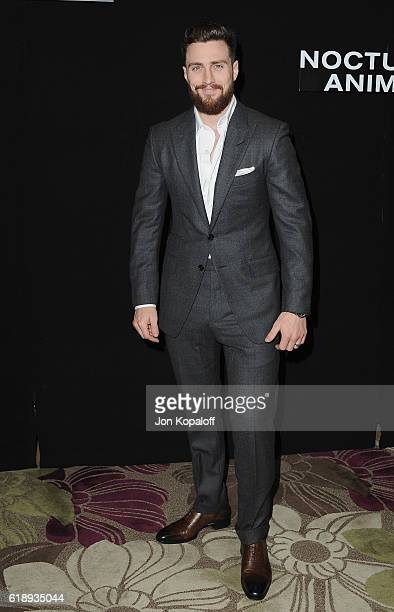 Actor Aaron TaylorJohnson attends the Photo Call For Focus Features' 'Nocturnal Animals' at Four Seasons Hotel Los Angeles at Beverly Hills on...