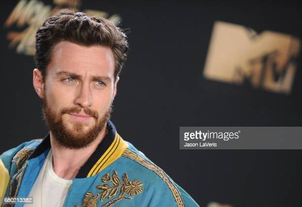 Actor Aaron TaylorJohnson poses in the press room at the 2017 MTV Movie and TV Awards at The Shrine Auditorium on May 7 2017 in Los Angeles California