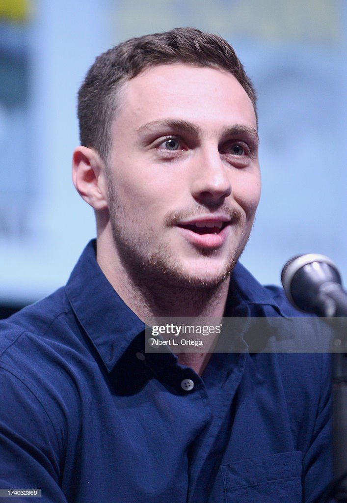 Actor Aaron Taylor-Johnson speaks onstage at the 'Kick-Ass 2' and 'Riddick' Panels during Comic-Con International 2013 at San Diego Convention Center on July 19, 2013 in San Diego, California.