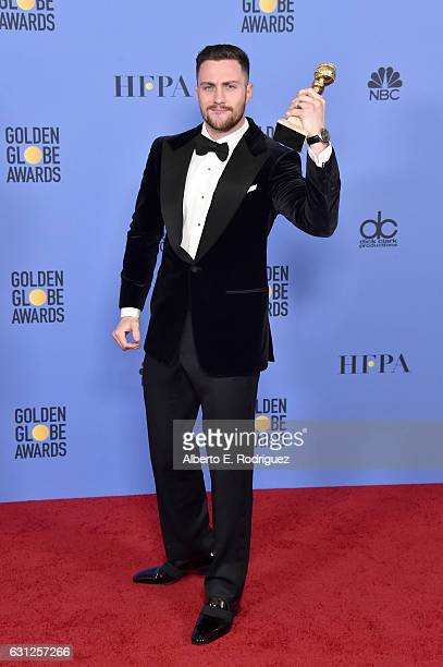 Actor Aaron TaylorJohnson winner of the Best Performance by an Actor in a Supporting Role in a Motion Picture award for 'Nocturnal Animals' poses in...