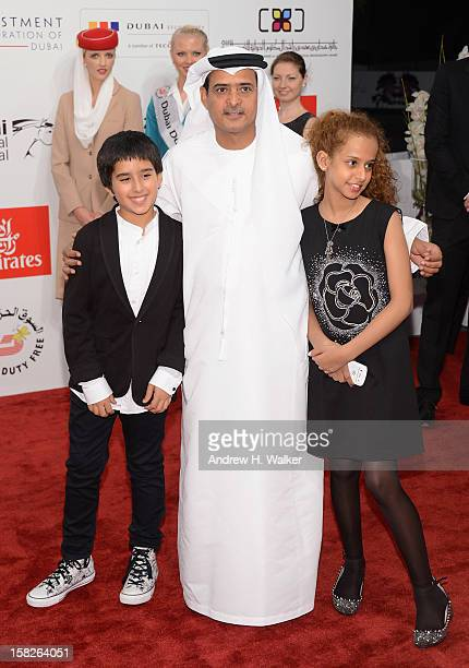 Actor Abdulrahman al Guhani DIFF Chairman Abdulhamid Juma and actress Waad Mohammed attend the 'Wadjda' premiere during day four of the 9th Annual...