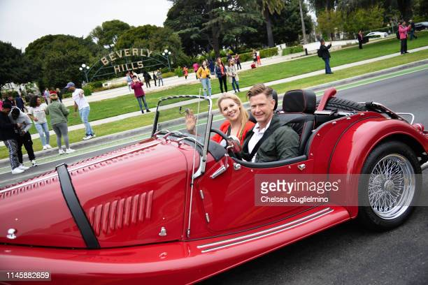 Actor Abi Titmuss drives past Beverly Gardens Park at the 2019 BritWeek Car Rally on April 28 2019 in Beverly Hills California