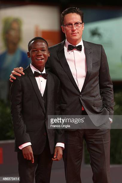 Actor Abraham Attah and director Cary Fukunaga attend the premiere of 'Beasts Of No Nation' during the 72nd Venice Film Festival on September 3 2015...