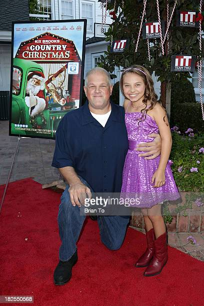 Actor Abraham Benrubi and actress Caitlin Carmichael attends 'A Country Christmas' Los Angeles Special Screening at The DeMille Theatre on September...
