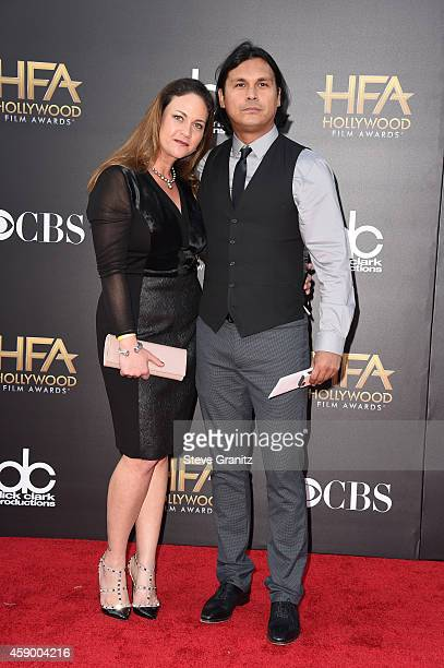 Actor Adam Beach and guest attend the 18th Annual Hollywood Film Awards at The Palladium on November 14 2014 in Hollywood California