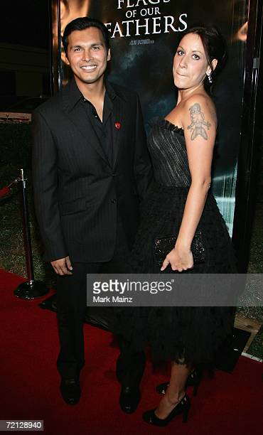 Actor Adam Beach and wife Tara Mason arrive at the premiere of Paramount's Flags Of Our Fathers October 9 2006 at the Academy for Motion Picture Arts...