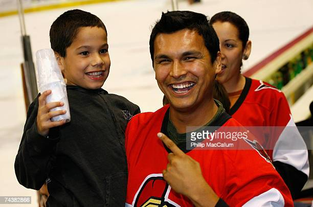 Actor Adam Beach attends Game Three of the 2007 Stanley Cup finals between the Anaheim Ducks and the Ottawa Senators with his son Luke at Scotiabank...