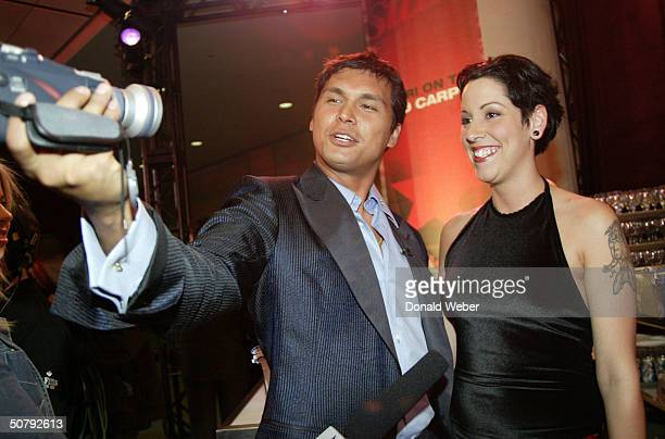 Actor Adam Beach films himself and his wife Tara Mason Beach at a cocktail reception during the 24th Annual Genie Awards at the Metro Convention...