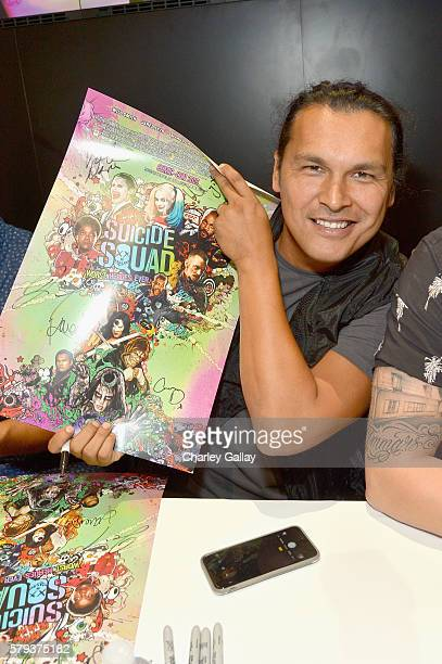 Actor Adam Beach from the cast of Suicide Squad film participates in an autograph session for fans in DC's 2016 ComicCon booth at San Diego...