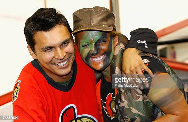 Actor Adam Beach poses with a fan at Game Three of the 2007 Stanley Cup finals between the Anaheim Ducks and the Ottawa Senators at Scotiabank Place...