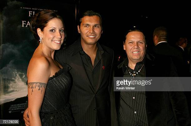 Actor Adam Beach wife Tara Mason and his dad arrive at the Paramount Pictures premiere of Flags Of Our Fathers held at the Academy of Motion Picture...