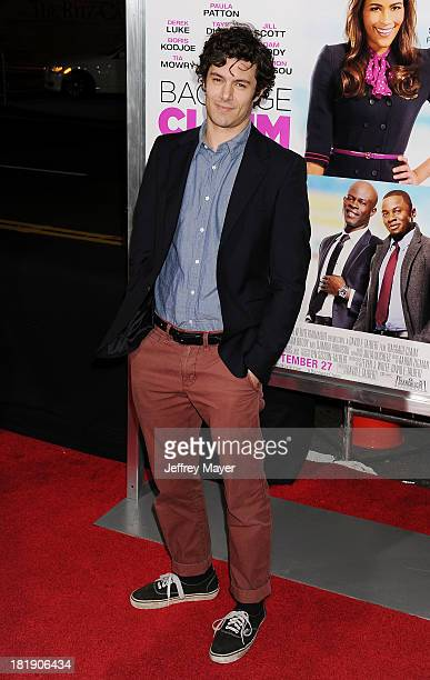Actor Adam Brody arrives at the Los Angeles premiere of 'Baggage Claim' at Regal Cinemas LA Live on September 25 2013 in Los Angeles California