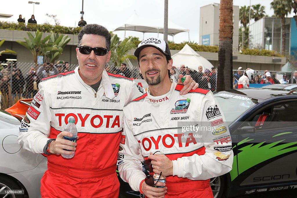 Actor Adam Corolla (L) and Adrien Brody (R) pose during the 36th Annual Toyota Pro/Celebrity Race - Press Practice Day of the Toyota Grand Prix of Long Beach on April 13, 2012 in Long Beach, California.