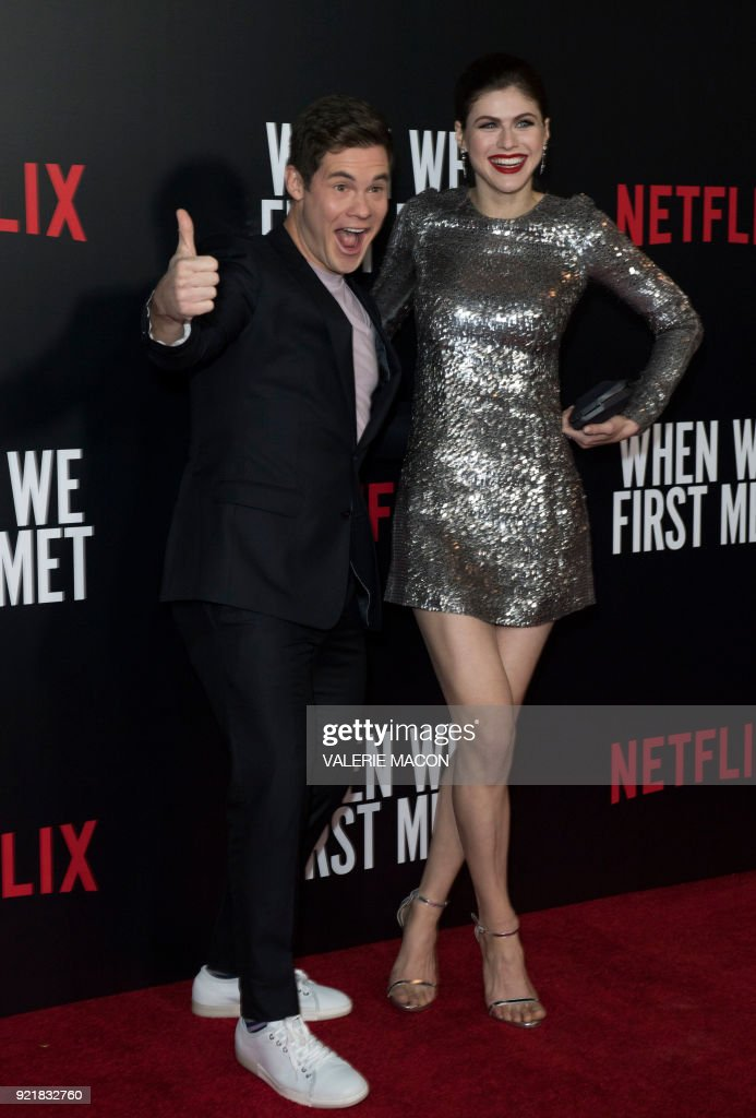 Actor Adam Devine (L) and actress Alexandra Daddario attend the Los Angeles special screening of Netflix's 'When We First Met,' on February 20, 2018, in Hollywood, California. /