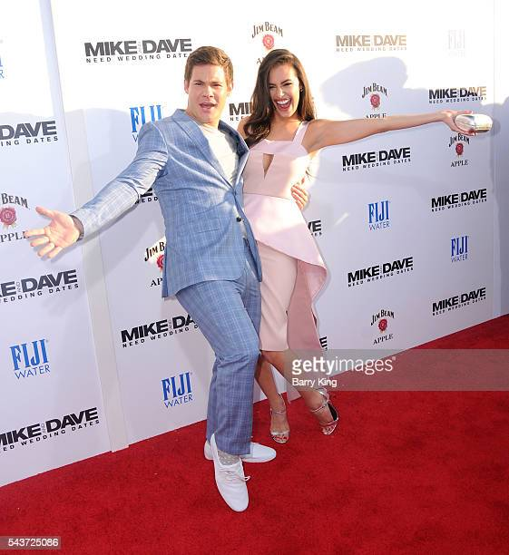 Actor Adam DeVine and actress Chloe Bridges attend the premiere of 20th Century Fox's' 'Mike And Dave Need Wedding Dates' at Cinerama Dome ArcLight...