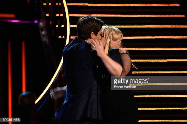 Actor Adam DeVine and actress Rebel Wilson accept the Best Kiss award for 'Pitch Perfect 2' onstage during the 2016 MTV Movie Awards at Warner Bros...