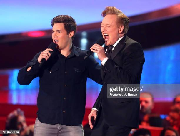 Actor Adam DeVine and host Conan O'Brien perform onstage at the 2014 MTV Movie Awards at Nokia Theatre L.A. Live on April 13, 2014 in Los Angeles,...