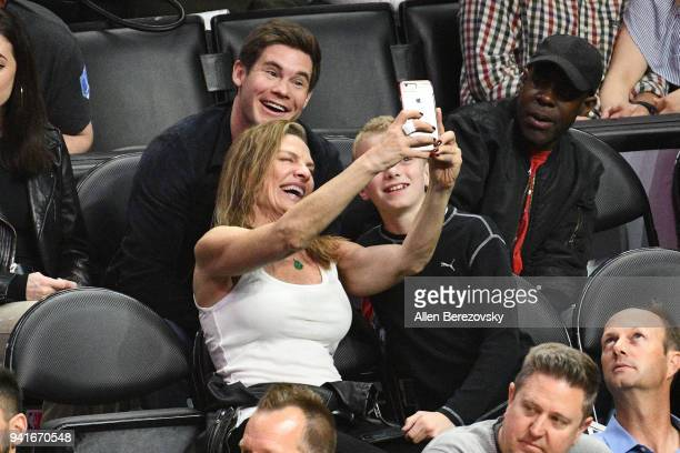 Actor Adam Devine poses for a selfie with fans during a basketball game between the Los Angeles Clippers and the San Antonio Spurs at Staples Center...