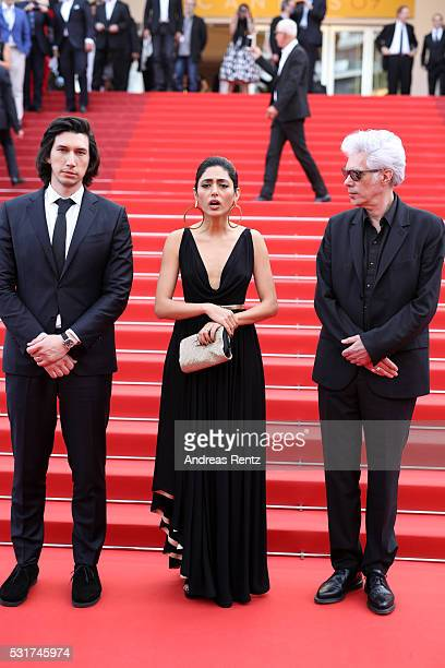 Actor Adam Driver actress Golshifteh Farahani and director Jim Jarmusch leave the 'Paterson' premiere during the 69th annual Cannes Film Festival at...